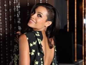 Rosario Dawson looking more exotica than social worker.